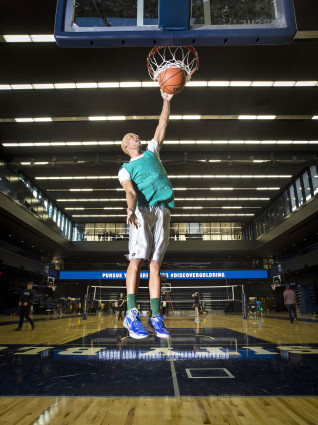 Fourth-year student McCair Tulloch goes up for a dunk at the new Goldring Centre for High Performance Sport. Photo by John Hryniuk