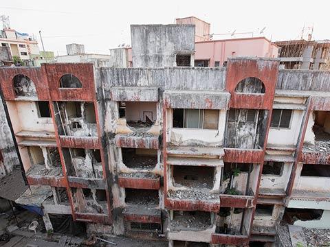 Photo of derelict apartments.