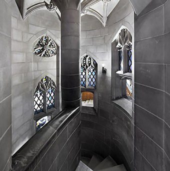 Black and white photo of staircase in the Great Hall with the middle window in colour
