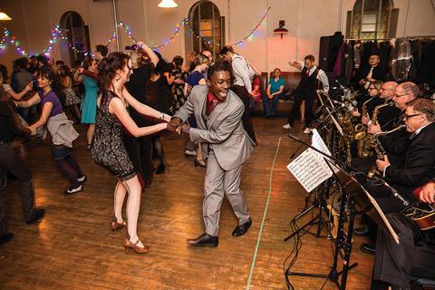Photo of people swing dancing.