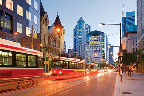 Photo of a Toronto street with a streetcar passing.