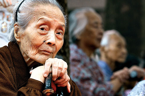 As a result of China's one-child policy, many young people are caring for aging parents. Photo: Corbis Wire