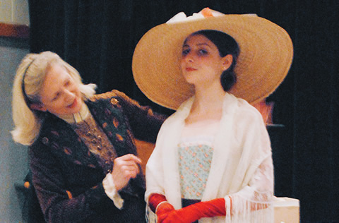 Actor Sharry Flett talks costumes with student Tatiana Haas