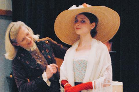 Actor Sharry Flett talks costumes with student Tatiana Haas
