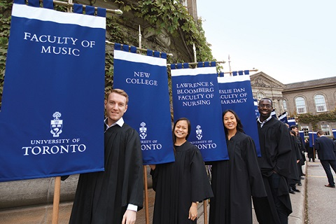 Students with U of T's first gonfalons.