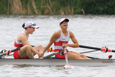 Rowers Kate Sauks and Liz Fenje on a rowboat.