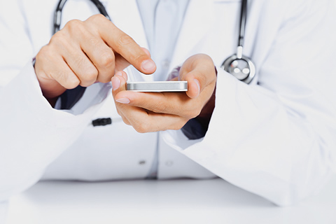 Photo of a doctor with a mobile phone.