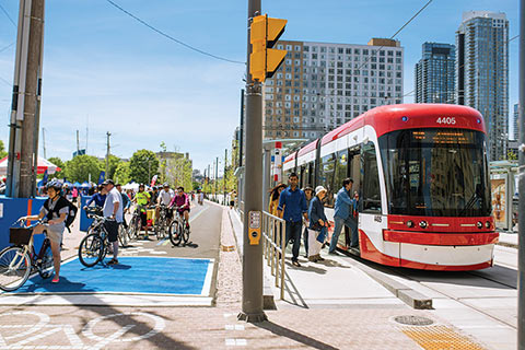 Photo of streetcar and bikers along Queen's Quay