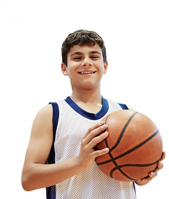 Close-up photo of a teenged boy in a tank top holding a basketball
