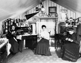 Three students enjoy a cup of tea in their room in Edwardian Toronto.Photo from City of Toronto Archives, Fonds 1244, Item 705A.