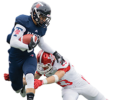 Photo of a Varsity football player running with the ball and a York player attempting a tackle
