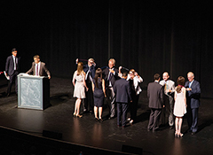 Photo of graduates on stage receiving their stethoscopes
