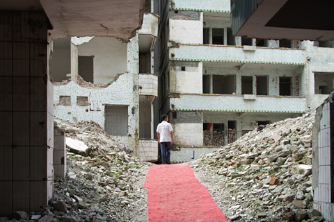 A man surveys the rubble in Guangzhou, China