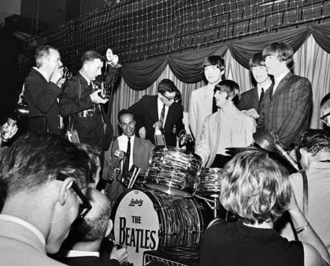 Photo of Robert Morris on stage with the Beatles.