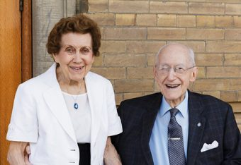Photo of elderly woman and man outside Convocation Hall