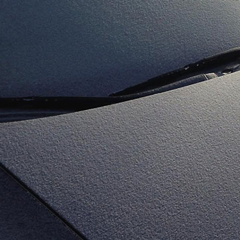 Photo of grey surface with fabric texture