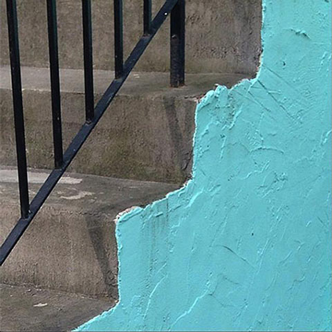 Photo of concrete steps with the side painted in aqua blue
