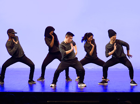 Photo of hip-hop dance group 9M5 performing onstage