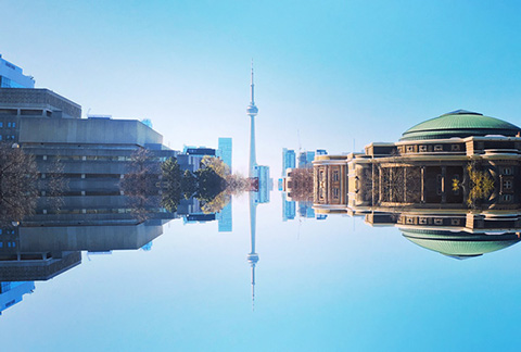 Photo of King's College Circle with the Medical Science Building, CN Tower and Convocation Hall on top and a mirror image on the bottom