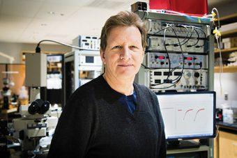 Photo of Graham Collingridge in a lab