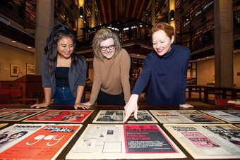 Photo of two students and Prof. Laurie Bertram in the Thomas Fisher Rare Book Library