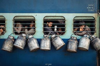 "People Winner: ""Milk Cartons on Side of Train"" by Arjun Yadav"