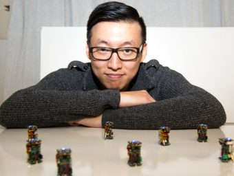 "Engineering PhD student Justin Kim has built nine robots not much larger than your thumb that exhibit ""swarm intelligence."" Photo by John Guatto."