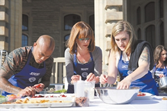 Mary Berg (centre) works with two teammates during a group challenge on MasterChef Canada. Photo courtesy of CTV.