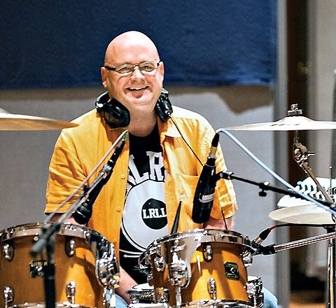 Photo of Jim Delaney with a drum set