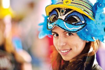 Close-up photo of Stephanie Gaglione with a blue, feathered mask