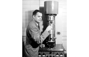 James Hillier with one of the first electron microscopes