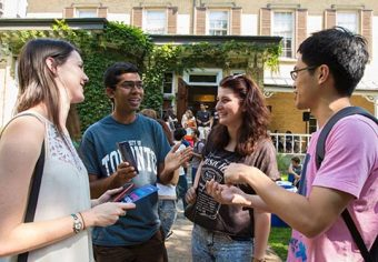 International students in conversation in front of Centre for International Experience