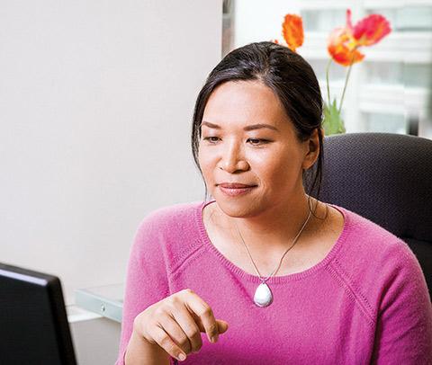 Closeup photo of Margaret Lam at her desk