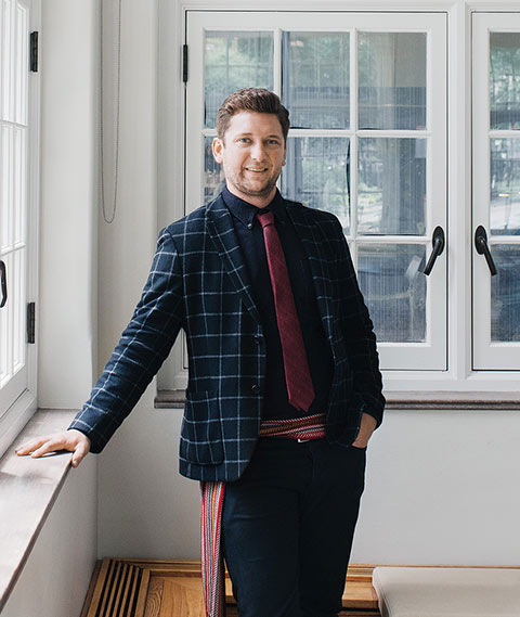 Musician Conlin Delbaere-Sawchuk, wearing the colourful woven sash that's a hallmark of Métis culture, thinks disputes over cultural appropriation could one day end up in court. Photo: Ian Patterson.