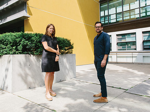 Photo of Prof. Shauna Brail and Prof. Mauricio Quiros-Pacheco standing in front of a building