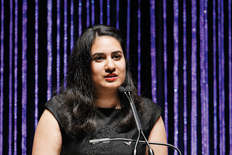Photo of Ishita Aggarwal giving a speech.