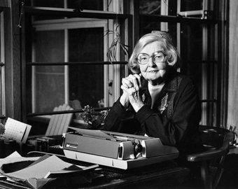 Photo of Edna Staebler at her desk.