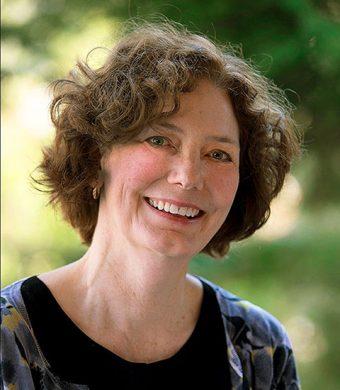 Outdoor headshot of Maureen Judge