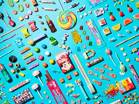 Photo of lost of different kinds of candy, representing a profusion of consumer choice.