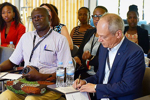 U of T president Meric Gertler (right) meets students at the African Institute for Mathematical Sciences in Rwanda.