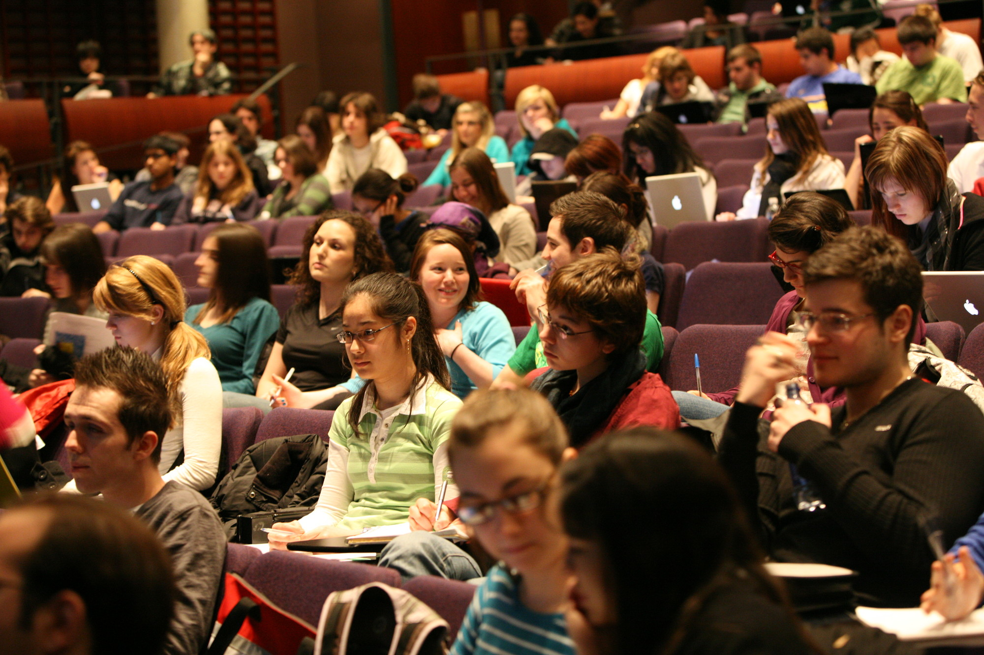 Students socialize before a first year history lecture.