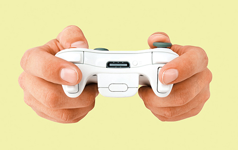 Photo of a pair of hands operating a video game controller.