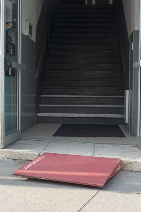 A stop gap ramp leading to a staircase