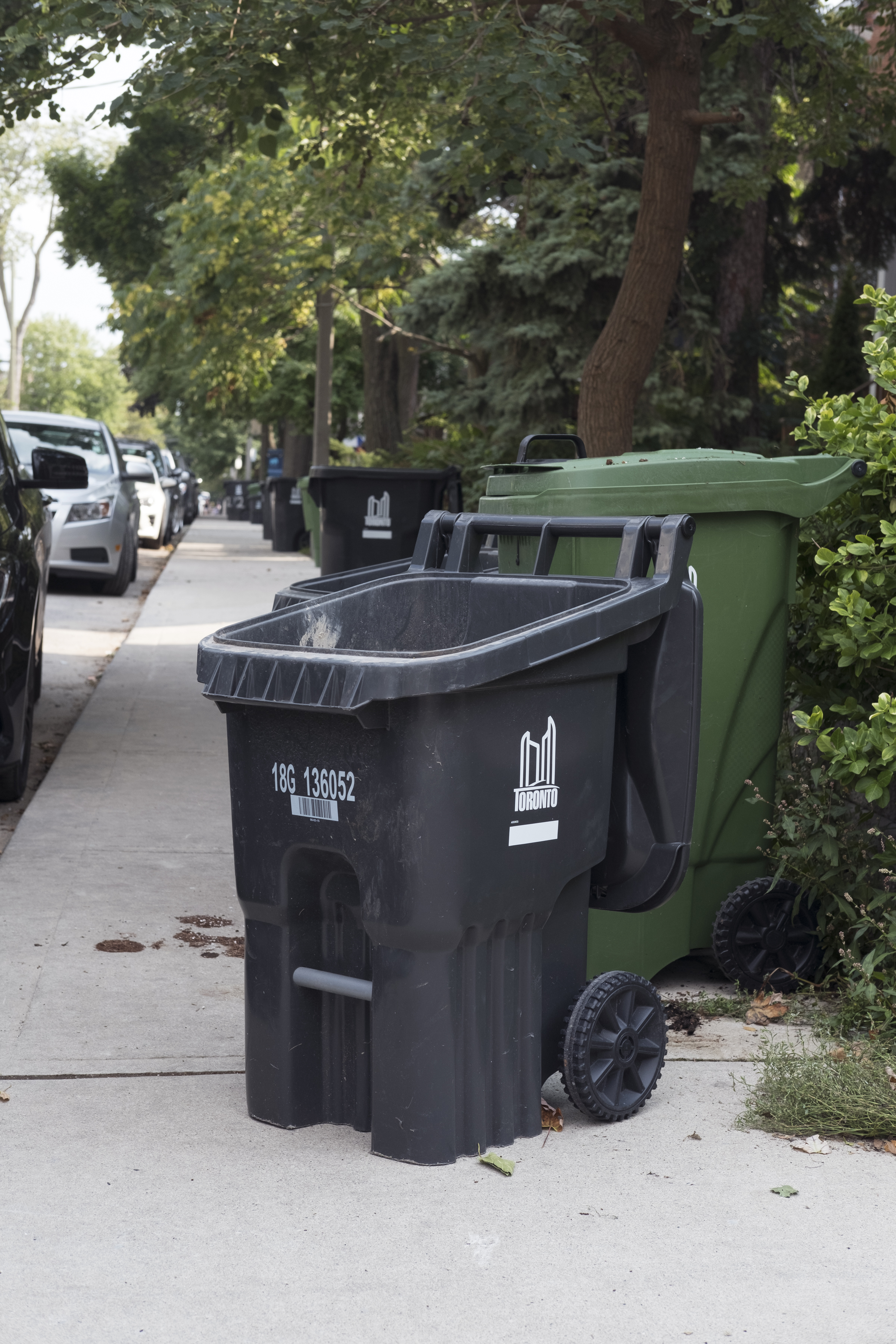 A City of Toronto garbage can blocking the sidewalk