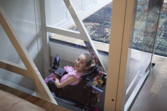 Asha Buliung, who is in a wheelchair, uses her home elevator