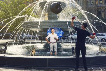 Claude Cormier stands in the dog fountain he designed in Berczy Park, Toronto