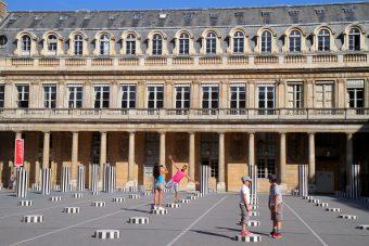"""Artist Daniel Buren's striped """"licorice"""" sculptures at Les Deux Plateaux, Palais-Royale, Paris"""