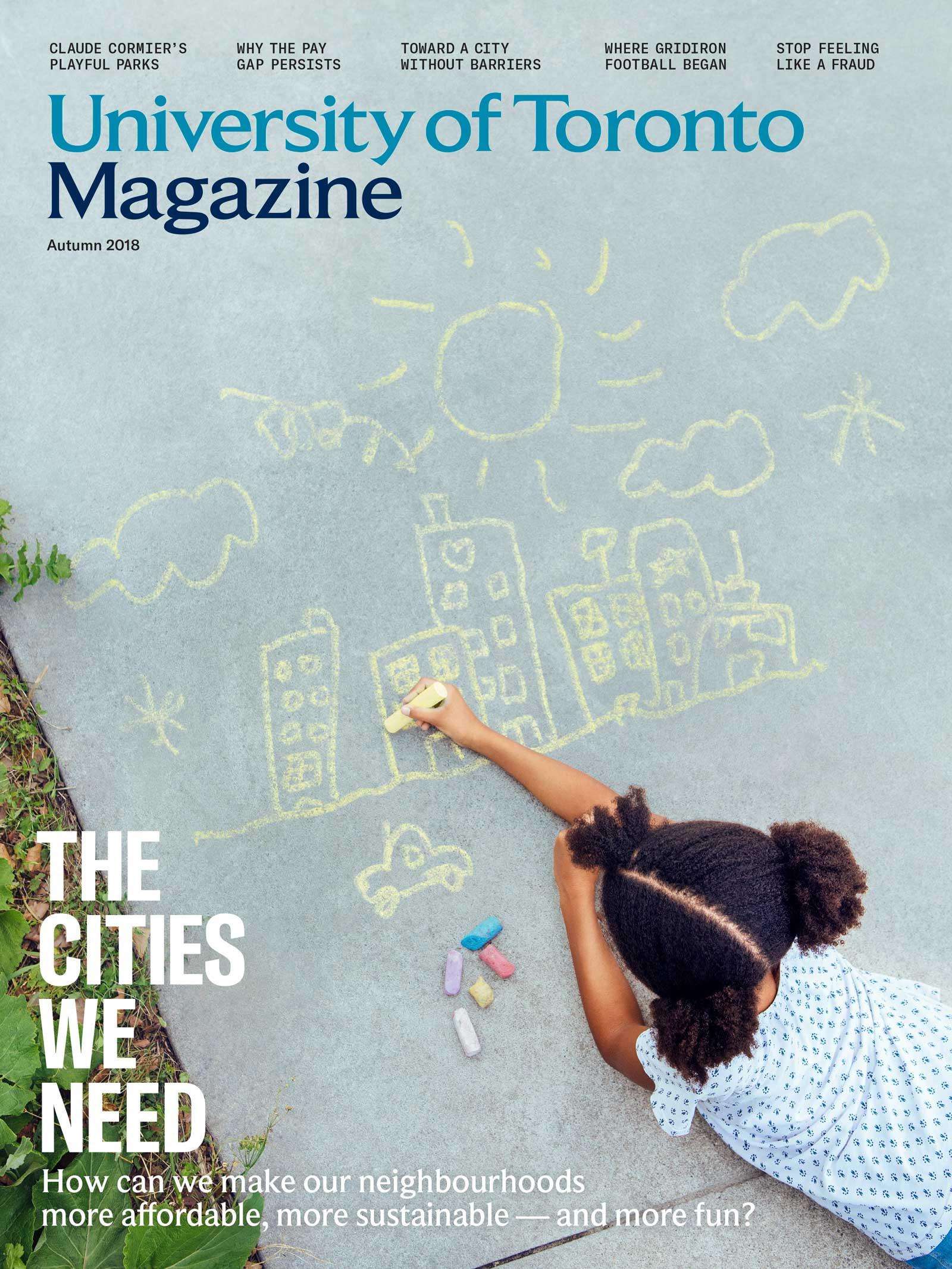 Girl draws a city with sidewalk chalk
