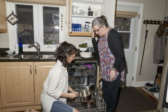 18-year old U of T student Zoe Butcher helps Catherine Finlayson, 61 empty the dishwasher. The two roommates are part of the Toronto HomeShare Pilot Project where university students are paired with senior-citizens who have a spare room in their homes. Students are expected to help out around the house doing chores and light housework in return for subsidized rent
