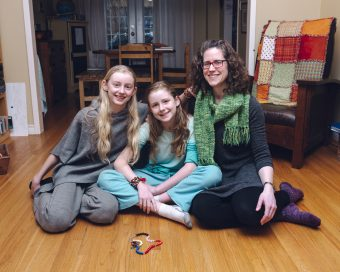 Laura Alary and her daughters in her home